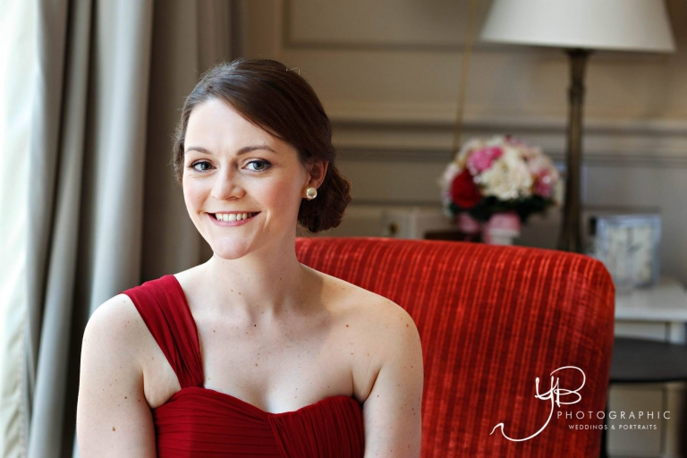 Bridal preparation photo of bride wearing red at Dean Street Townhouse