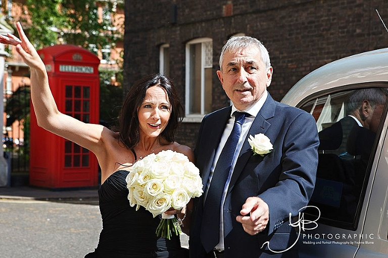 The bride arrives at Mayfair Library with her dad.