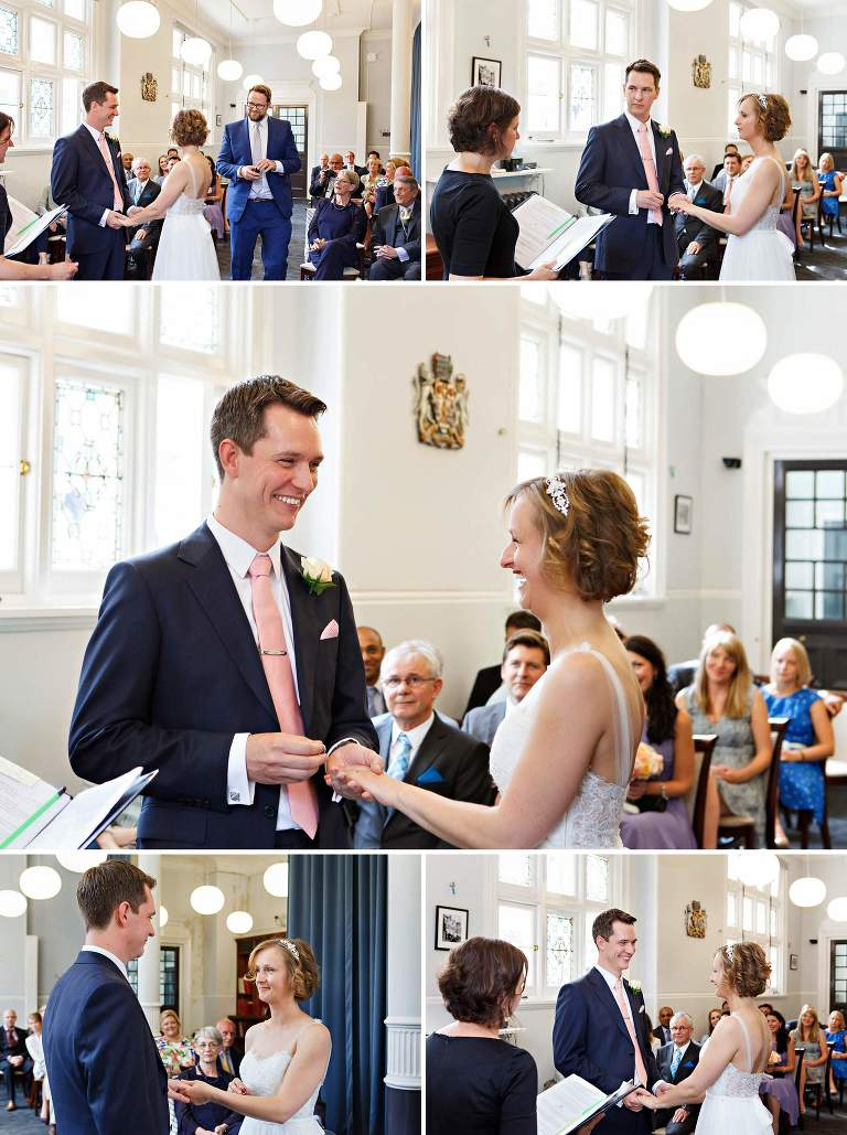 the bride and groom exchange rings during their Mayfair Library summer wedding ceremony.