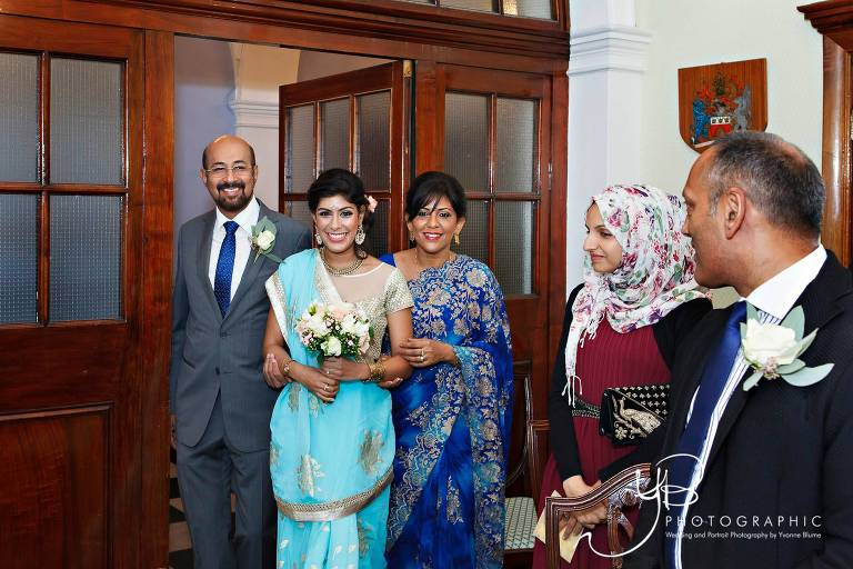 Asian Bride is walked into Chelsea Register Office ceremony by her parents