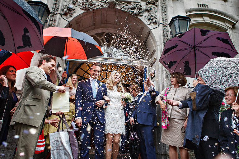 What to do if it rains on your wedding day in London? The same as you usually would! Throw confetti as they normally would on the steps of Chelsea Old Town Hall - just with umbrellas.