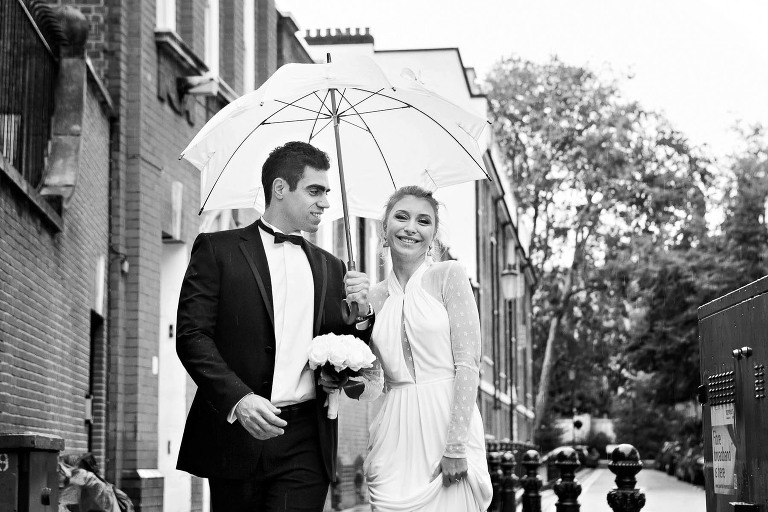 Rain on your wedding day is good luck in Italy. It's also a great opportunity to play with a white umbrella throwing soft light onto your face - great for portraits!