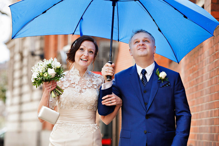 An umbrella big enough for two on this rainy wedding day at Chelsea Register Office on the Kings Road. Rainy day weddings are nothing to worry about!