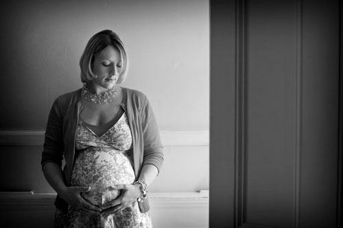 Black and white photograph of a pregnant woman