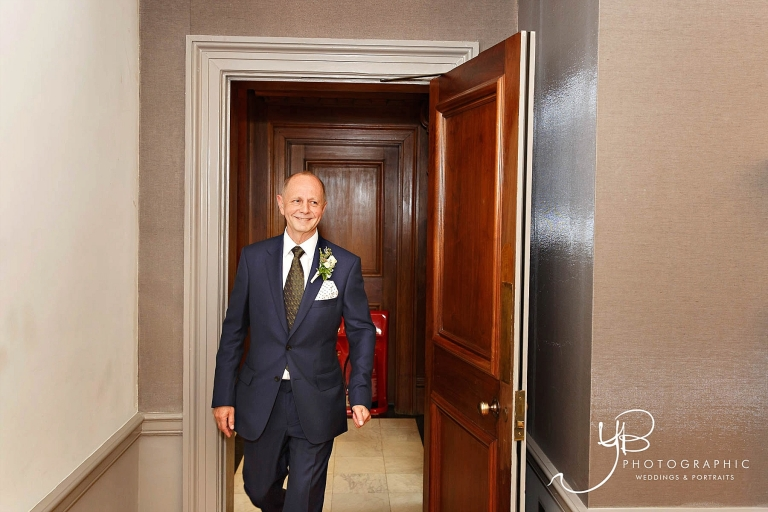 Groom Ray looks ready for his Mayfair Room wedding ceremony.