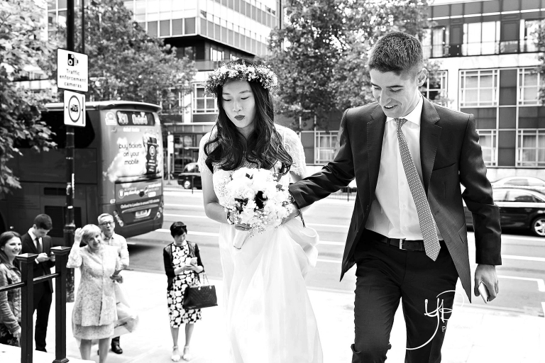 A bride and groom arrive for their Soho Room civil marriage ceremony, with the bride wearing a flower crown.