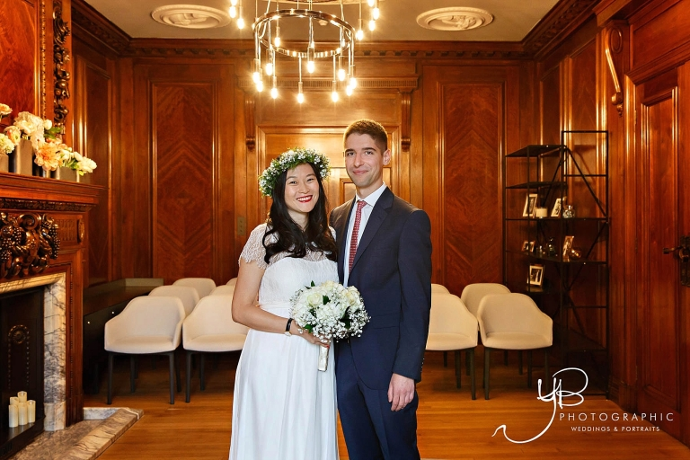 A wedding portrait of the bride and groom in Westminster's Soho Room.