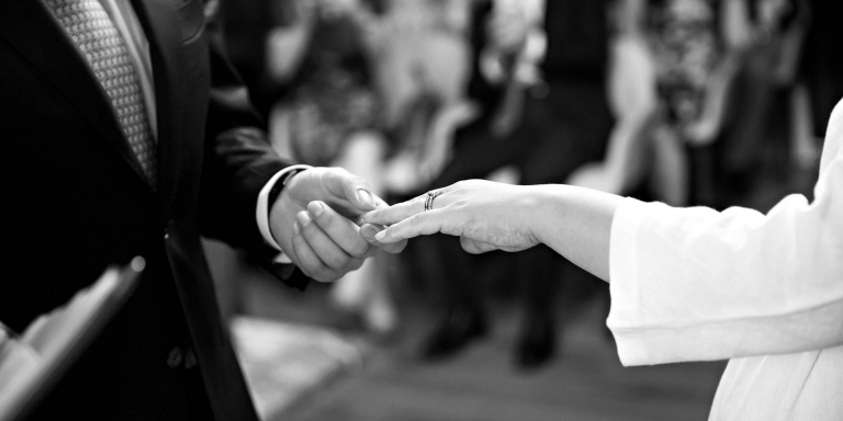 A couple exchanges rings during their civil wedding ceremony at Marylebone Old Town Hall in front of close family and friends. The home of Westminster Register Office on Marylebone Road has seven ceremony rooms for civil marriages and civil partnerships.