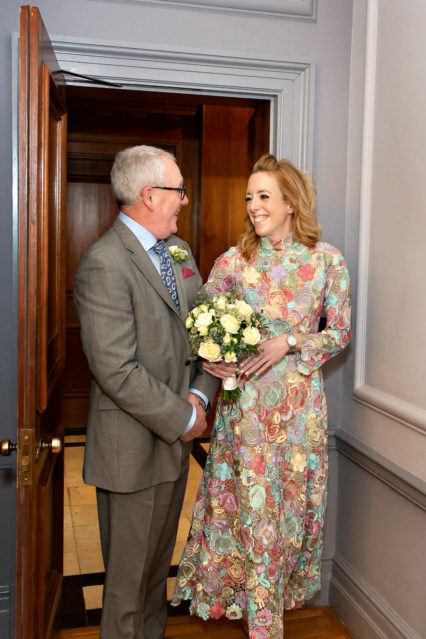 A bride and her father enter the Knightsbridge Room at Old Marylebone Town Hall.