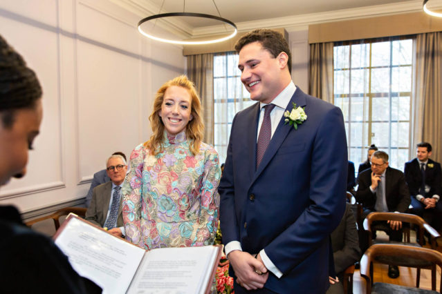 A bride and groom exchange their vows during their civil marriage ceremony in the Knightsbridge Room in Westminster Registry Office.
