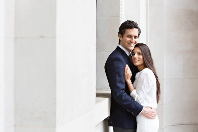A bride and groom pose for wedding photos at the front of Old Marylebone Town Hall.