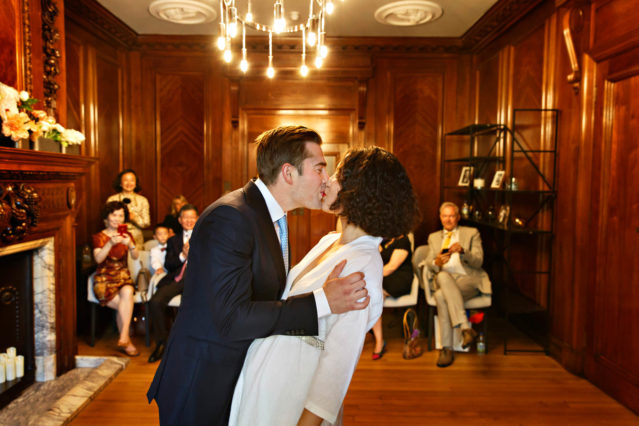 A bride and groom kiss during their Marylebone Room wedding ceremony at Old Marylebone Town Hall.