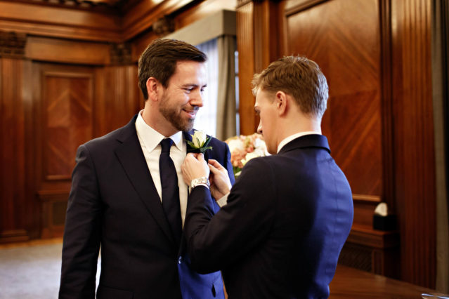 Two grooms get ready for their Marylebone Room wedding ceremony.