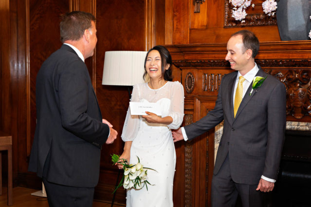 The bride and groom receive their marriage certificate after their Marylebone Room wedding ceremony.