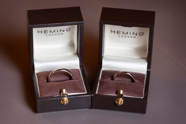 Two wedding rings sit in their boxes in the Paddington Room at Old Marylebone Town Hall.