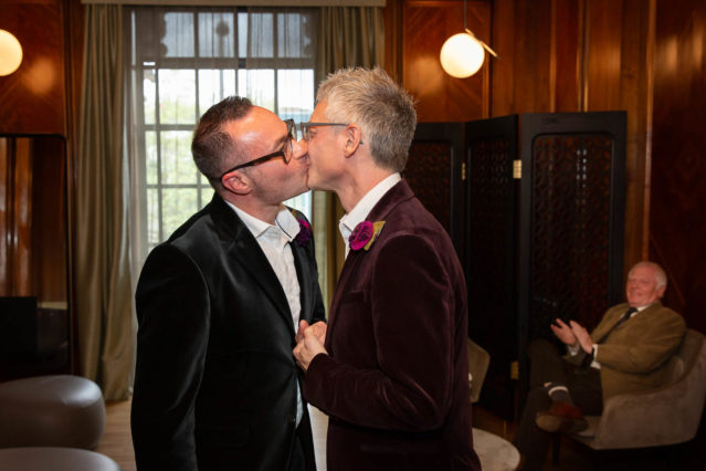 Grooms kiss after their same sex marriage ceremony in the Paddington Room, Marylebone in central London.