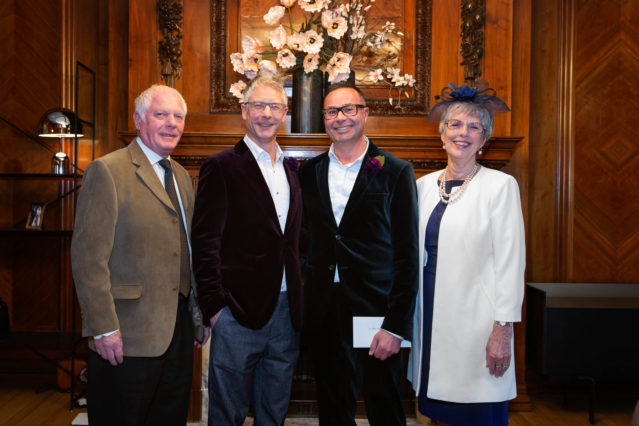 Grooms stand with their two witnesses after their small wedding ceremony in the Paddington Room, Marylebone.