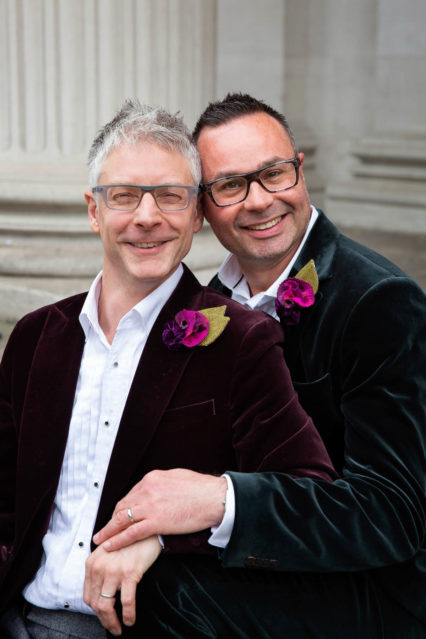 Grooms pose for wedding portraits after their Marylebone Old Town Hall ceremony.
