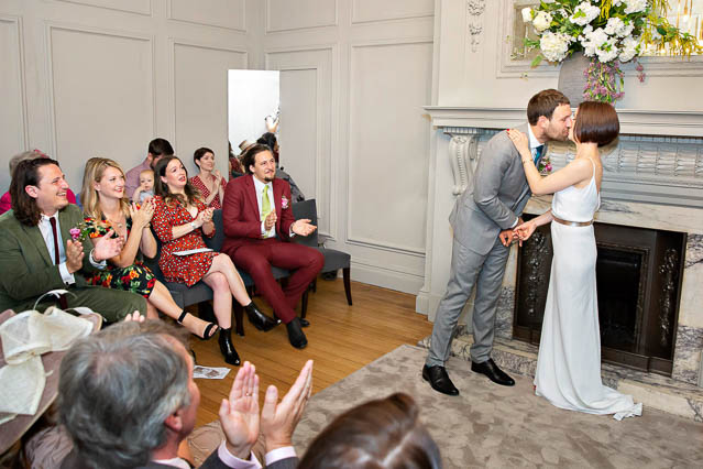 The bride and groom kiss after being announced man and wife in Westminster Registry Office's Soho Room.