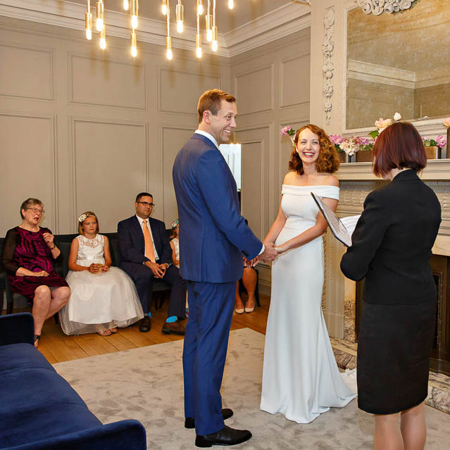 The bride and groom exchange vows in the Soho Room.