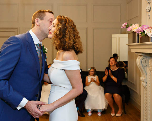 The bride and groom kiss after being announced husband and wife in a Soho Room civil ceremony in London's Marylebone. Photo: Yvonne Blume