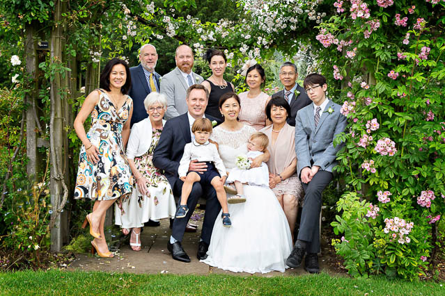 A family group portrait in Regents Park after a civil wedding at Westminster's Old Marylebone Town Hall.