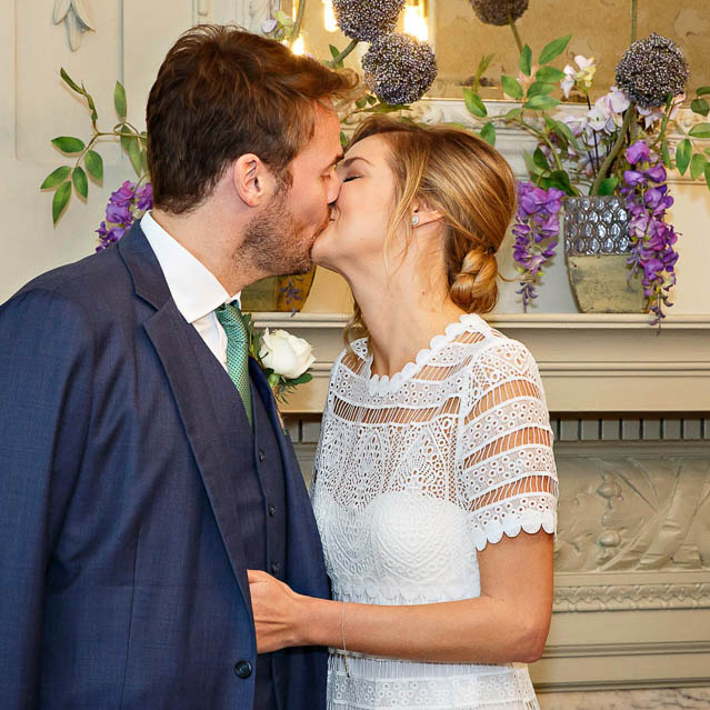 The bride and groom kiss after they are announced man and wife in their civil marriage ceremony at Marylebone.