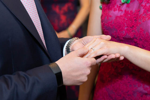 A groom puts the wedding ring on his bride-to-be in a civil marriage ceremony in Marylebone.
