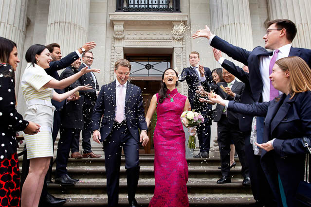 A confetti cloud floats onto the new Mr and Mrs at Marylebone Old Town Hall.