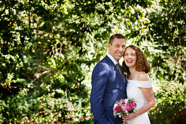 A bride and groom have portraits in Regents Park after their civil marriage ceremony. You need a permit for photos in Regents Park which you can obtain ahead of your wedding from the Royal Parks.
