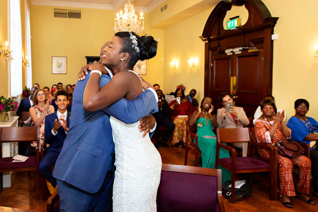 The bride and groom hug after they are married in the Kings Road register office in Chelsea Town Hall.