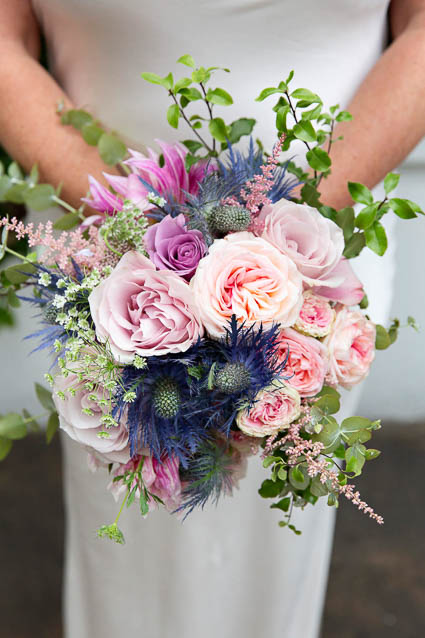 A summer wedding bouquet of pinks and Scottish heathers and thistles.
