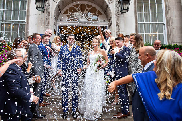 Guests throw confetti over the bride and groom on the steps of Chelsea Town Hall on the Kings Road, SW3.
