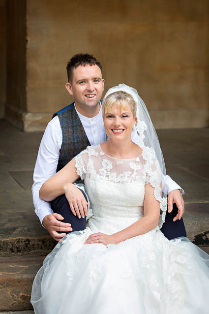A bride and groom pose for wedding portraits after their elopement to Chelsea Town Hall in London.