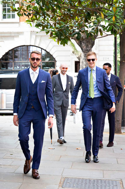A groom and his groomsmen walk into Kensington and Chelsea Register Office on the Kings Road in London.