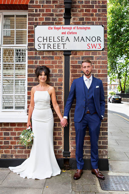 A bride and groom pose for portraits after their Kensington Registry Office wedding.