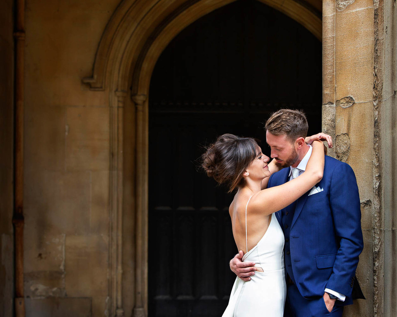 A pair of newlyweds pose for wedding portraits after their Chelsea Town Hall wedding.