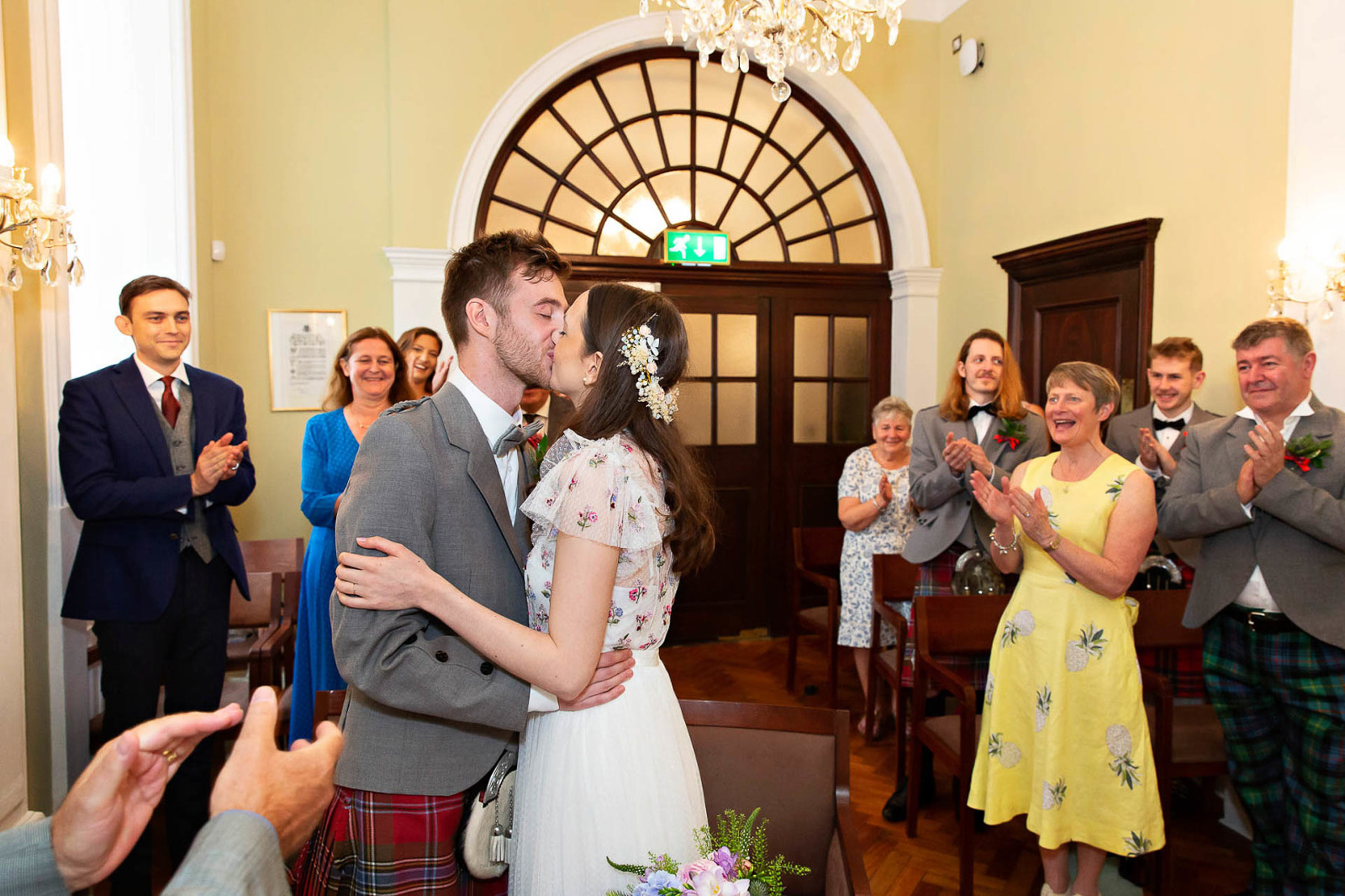 Bride and groom kiss after being announced man and wife after their civil wedding in the Rossetti Room at Chelsea Town Hall on Kings Road.