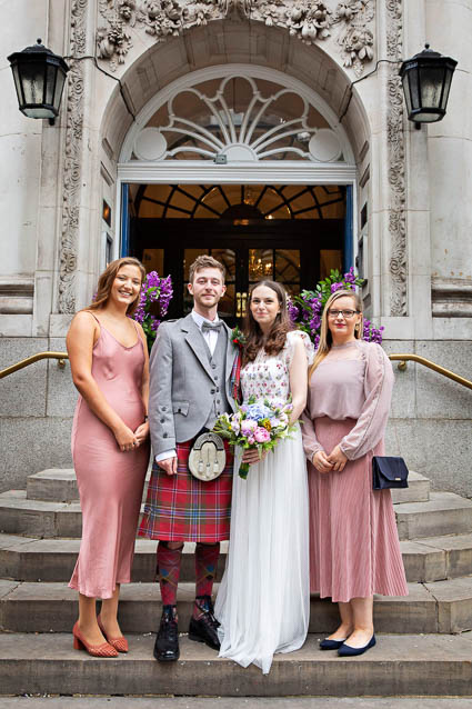 Wedding guests stand on the steps of the Chelsea Register Office on Kings Road in Kensington, London.