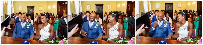 The bride and groom have a giggle during their civil marriage ceremony a the Chelsea Old Town Hall by ybphotographic